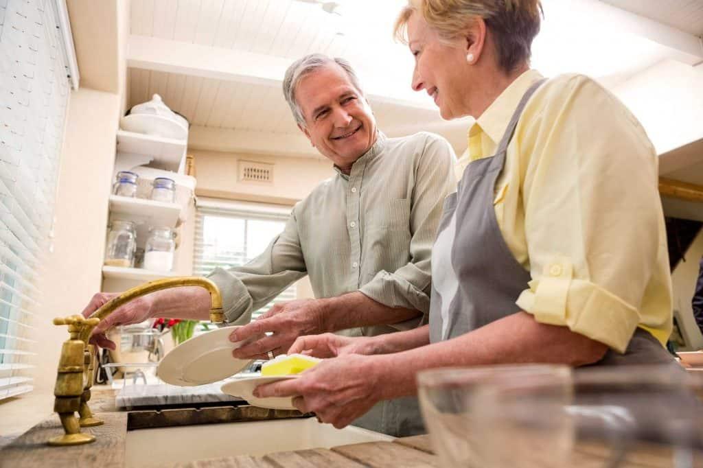old couple washing dishes
