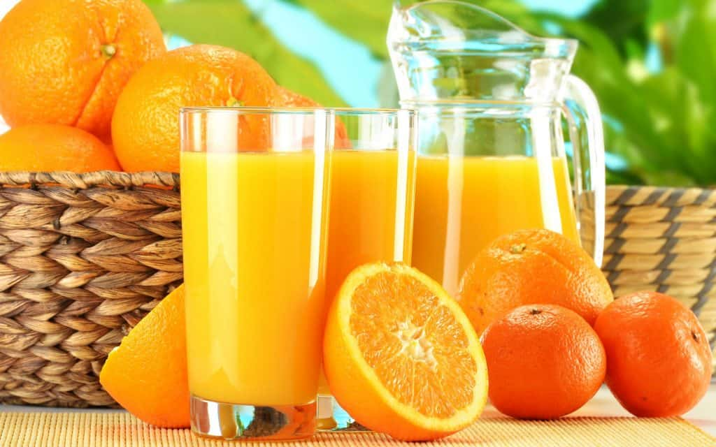 orange fruits and juices