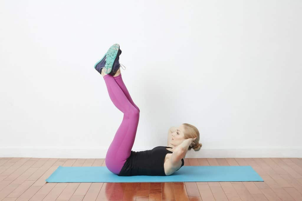 Woman having Leg Raise Crunch