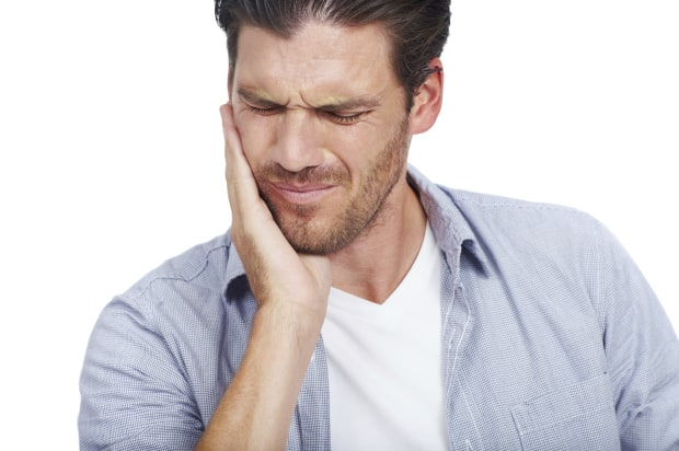 man in tooth pain