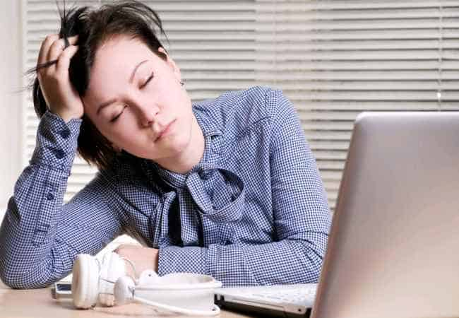 woman sleeping while working