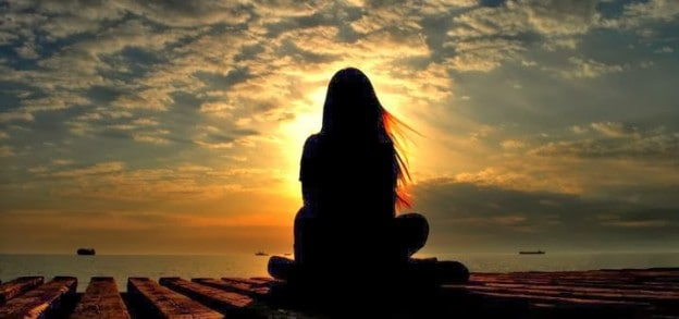 woman meditating in the morning
