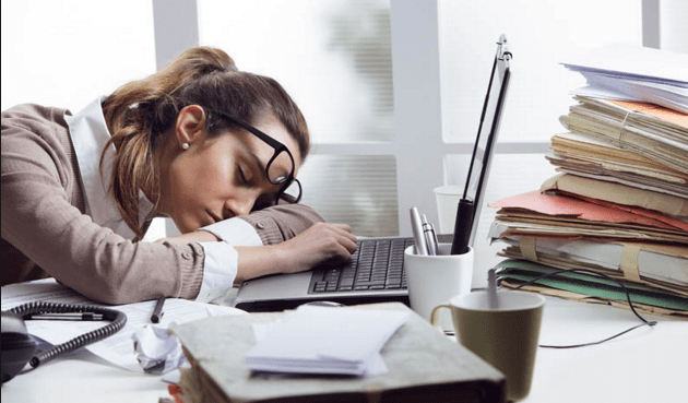 woman taking a nap while working