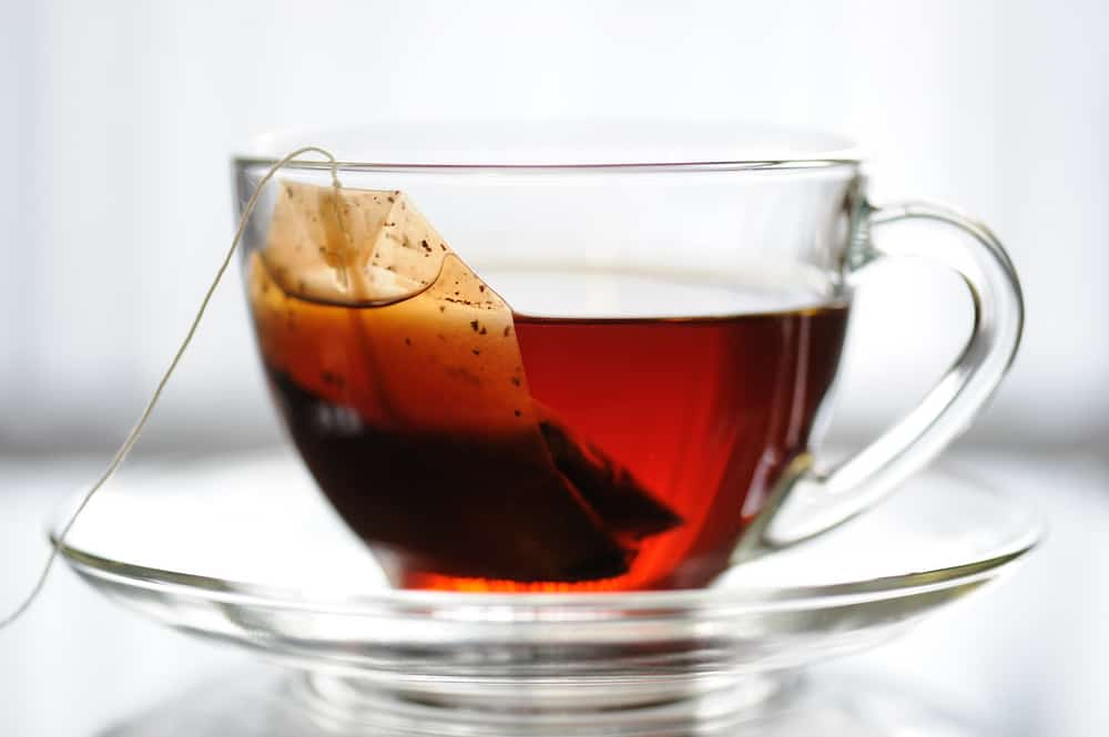 real tea bag in cup
