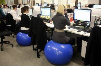 people uses exercise balls as office chair