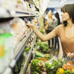 a woman picking healthy foods