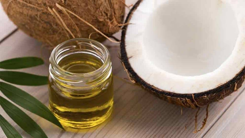 a glass of oil extracted from coconut