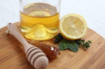 a glass of honey and lemon