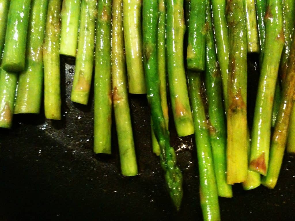sauteed asparagus in a frying pan