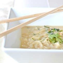 a bowl of ramen noodles with chopsticks