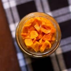 a jar of turmeric and ginger pickles