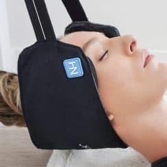 woman relieving neck pain with neck hammock