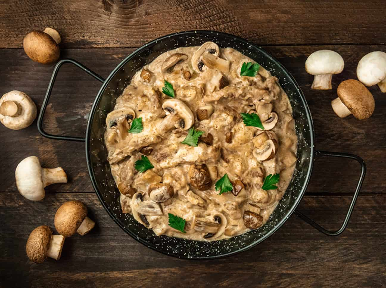 a pot of beef stroganoff with mushrooms and sour cream