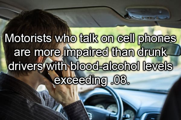 man talking while driving